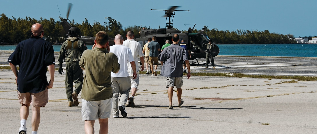 At the end of the urban navigation, members of the 201st Airlift Squadron are flown to a simulated safe location by a D.C. Army National Guard UH-1 helicopter March 13. The evacuation is part of their two-day annual survival training at Naval Air Station Key West, Fla. (U.S. Air Force photo/ Tech. Sgt. Adrianne Wilson)