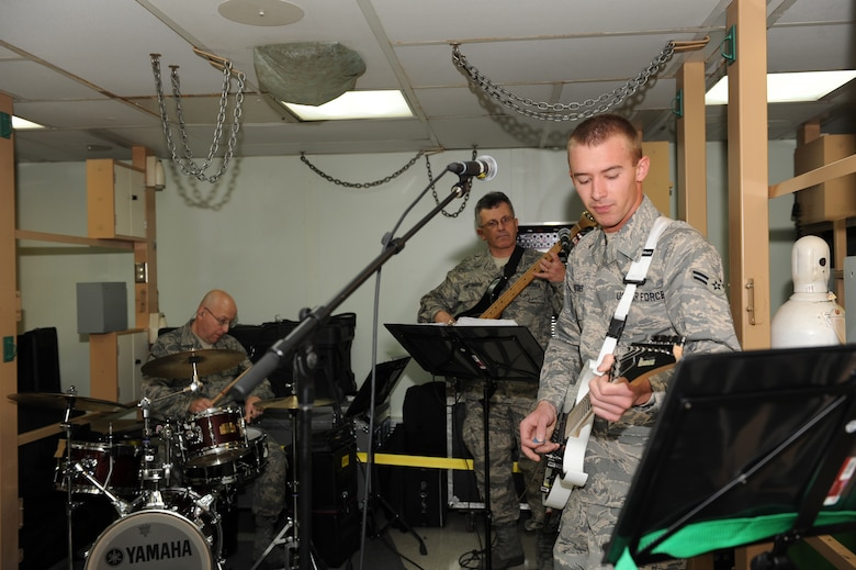 USNS COMFORT T-AH 20 --  Members of the Star Lifter Rock Band rehearse in preparation for their deployment on the USNS Comfort March 25.  The Comfort is deploying for the Continuing Promise 2009 mission which provides humanitarian aid to partner nations in the U.S. Southern Command area of focus.  (U.S. Air Force photo by Senior Airman Jessica Snow)