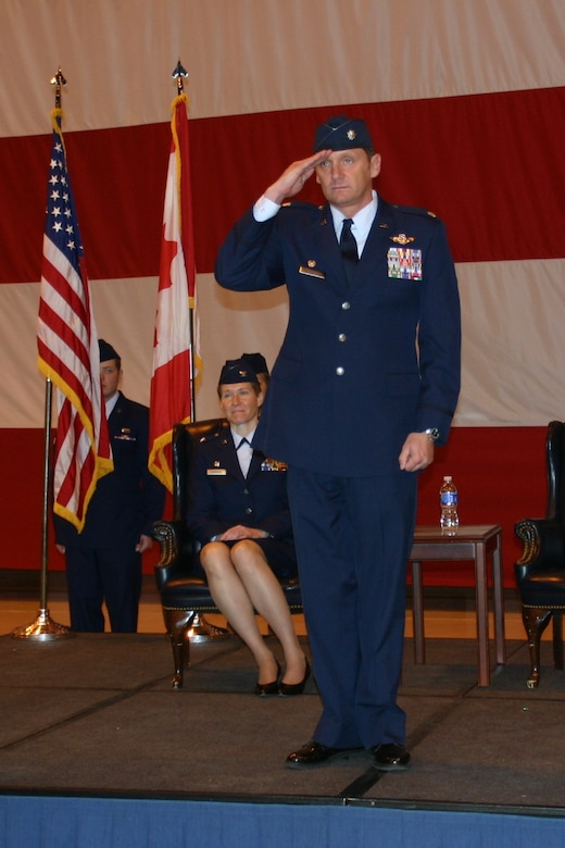 Lieutenant Col. Jimmy Warren accepts his first salute from the Golden Falcons after assuming command of the 965th Airborne Air Control Squadron March 23.