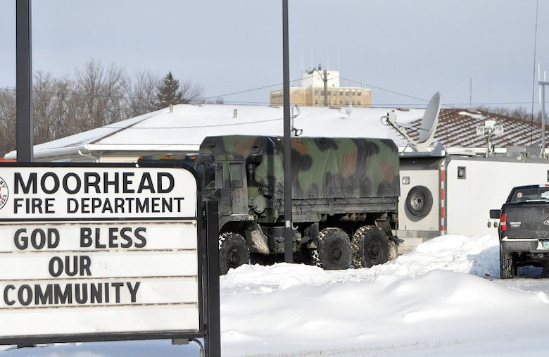 One of Minnesota  Joint Communications Platform (JCP), behind military vehicle, is deployed to Moorhead, Minn. during the Red River flooding emergency of March 2009. JCPs are critical for providing military and commercial internet access at the incident command site.