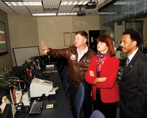 Col. Russ Walz, 114th Fighter Wing commander explains the operations inside the 114th Figher Wing Command Post to U.S. Ambassador Lisa Bobbie Schreiber Hughes and Suriname Defense Minister Ivan Fernald. Ambassador Schreiber Hughes and Defense Minister Fernald were in South Dakota as part of the Growth through Partnership program.