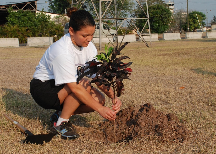 "SOTO CANO AIR BASE, Honduras -- Army Sgt. Diana Guevara, Joint Task Force-Bravo's NCO of the Quarter, plants a tree in front of the Oasis to commemorate Women's History Month here March 30.  Nearly 150 members of JTF-B participated in a ""Save our Planet"" walk around the base as they learned about the native trees here and picked up trash.  (U.S. Air Force photo/Tech. Sgt. Rebecca Danét)"