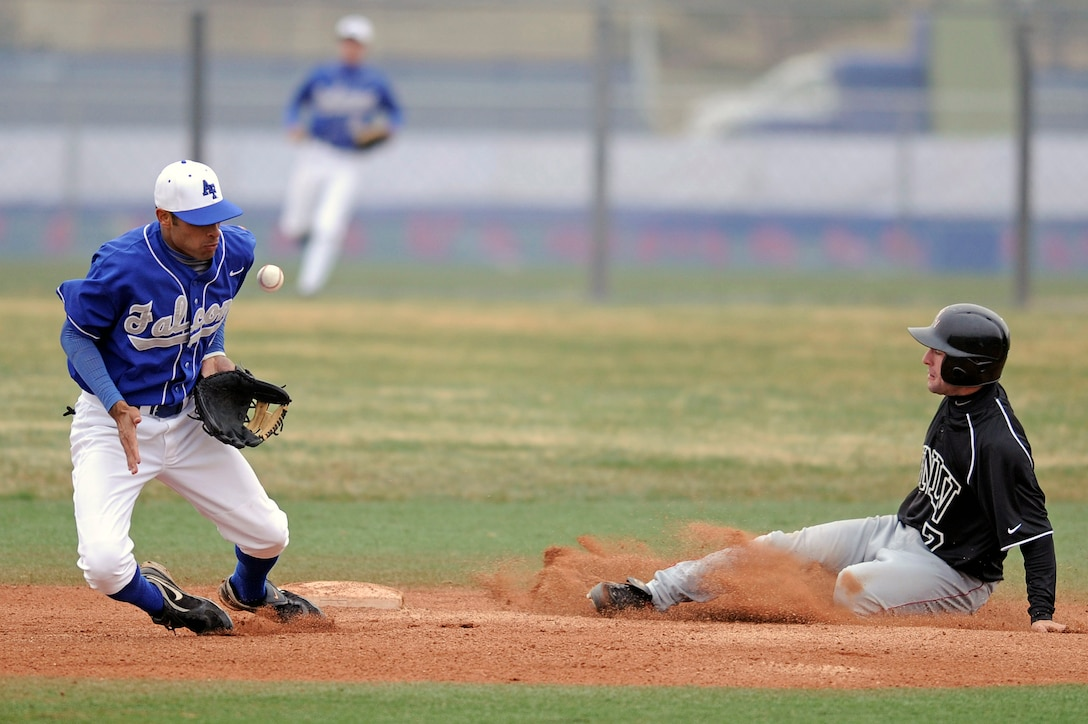 U.S. Air Force Academy junior shortstop K.J. Randhawa stops a badly thrown ball as UNLV steals 2nd base during the 20-13 loss to the University of Nevada, Las Vegas at Falcon Field April 25 at the Academy in Colorado Springs, Colo. The loss dropped Air Force to 14-25 overall, with a Mountain West Conference record of 3-8. (U.S. Air Force photo/Mike Kaplan)
