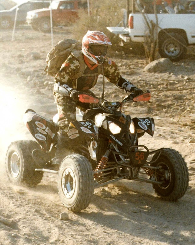 Tech. Sgt. Brent Renholm, 302nd Operations Group life support technician, races his ATV March 13-15 through the desert sands of Baja California in Mexico during the 23rd ANNUAL TECATE SCORE San Felipe 250 all-terrain motor race. As first-time racers, both Sergeant Renholm and a friend placed 10th in their division during the race. (Courtesy photo)