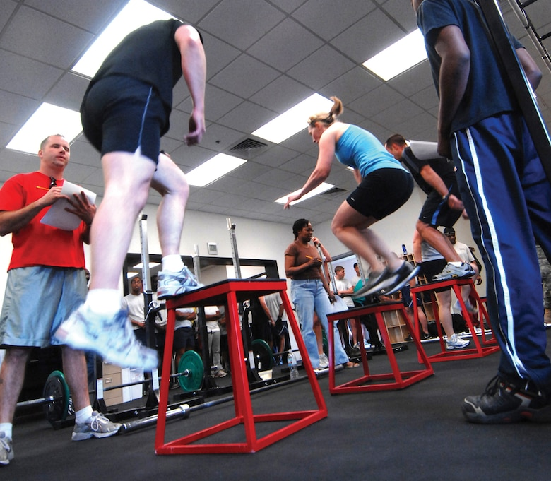 "Competitors perform the ""box jump"" portion of the CrossFit Challenge. The CrossFit program attempts to be as inclusive as possible, gearing its flexible regimen to be accessible to everyone from elite athletes to homemakers. (U.S. Air Force photo/ Tech. Sgt. Jeffrey Wolfe.)"