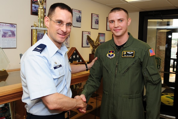 Col. C.K. Hyde, 314th Airlift Wing commander, presents Staff Sgt. Zach Nagy, a 48th Airlift Squadron loadmaster instructor and student evaluator, with a coin for his selection as the Combat Airlifter of the Week Monday. Sergeant Nagy is responsible for all the 48th AS's assigned personnel's annual ground and flying training events. Additionally, Sergeant Nagy tracked and validated annual ground and flight training for all assigned personnel ensuring a 100 percent completion rate of all annual currencies.