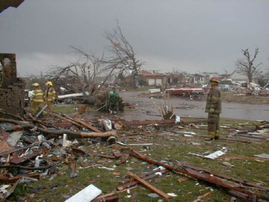A Del City firefighter surveys damage that affected both the military and civilian community surrounding Tinker Air Force Base following the May 3, 1999 tornado. (1999 file photo)