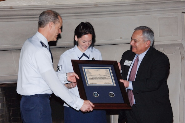 In honor of the first group of graduates of the Air University Associate-to-Baccalaureate Cooperative program, Lt. Gen. Allen Peck, Air University commander, and Tito Guerreo, Air University Board of Visitors chair, presented a plaque of recognition to Staff Sgt. Lisa Kilpatrick. Sergeant Kilpatrick, an Airman Leadership School instructor from Eglin Air Force Base, Fla., was one of the first to complete her ABC degree, accepted the plaque on behalf of all the members of the first cohort of ABC program graduates at a BOV luncheon at the Maxwell Officers Club April 22. At the event, board members had the opportunity to talk with current students of the program about their experiences, and the education they are receiving. (U.S. Air Force photo by Melanie Rodgers Cox)