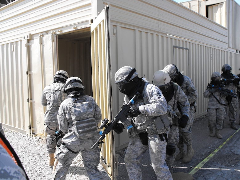 A security forces team prepares to enter and clear a building of hostiles during Patriot Defender Training in Mineral Wells, Texas at Fort Wolters Military Reservation March 13 through March 29, 2009.  (photo courtesy of Master Sgt. John Gasiorek)