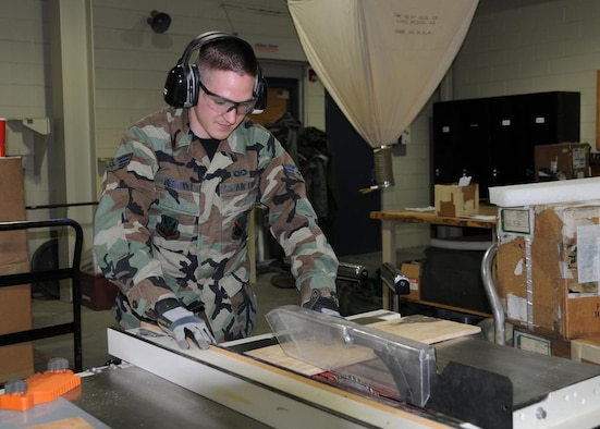 Senior Airman Bermudez cutting plywood for a shipping case.