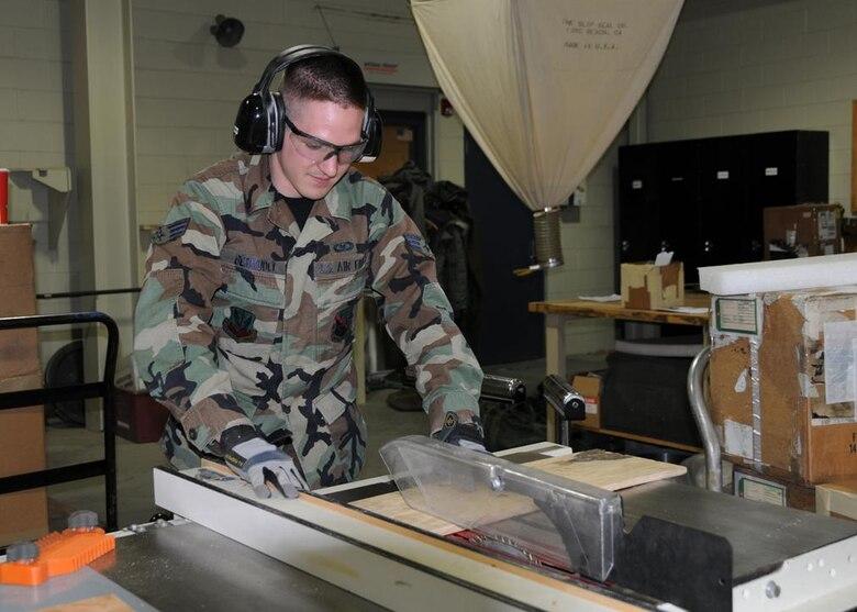 Senior Airman Bermudez cutting plywood for a shipping case.