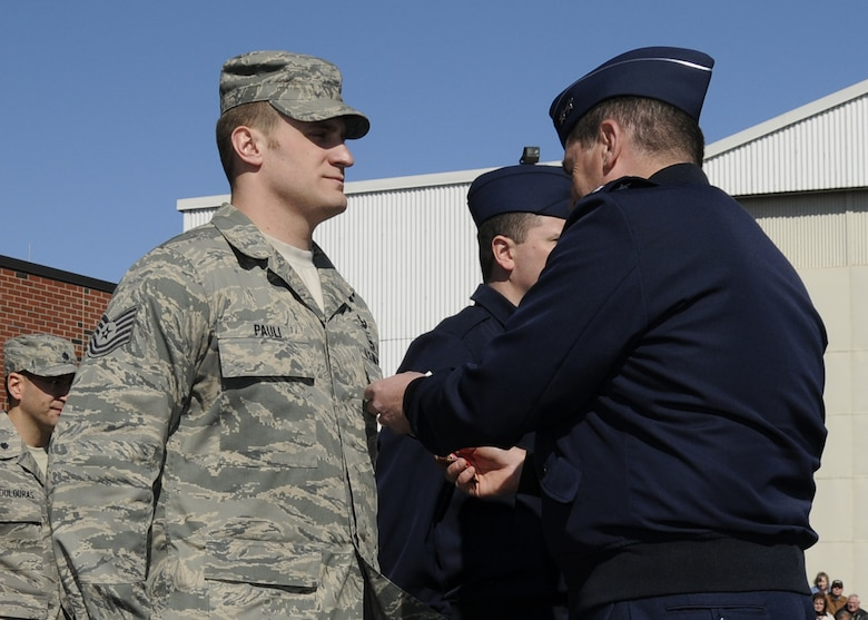 Tech. Sgt. Gregory Pauli receives the Bronze Star with Valor from Gen Michael Akey during the April UTA.