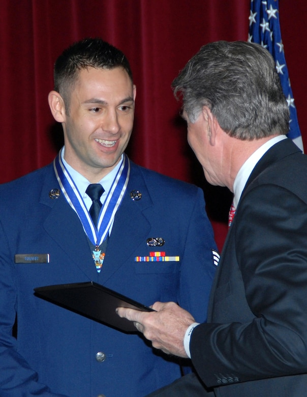 "Senior Airman Josh Knarr, 124 APF, accepts the Idaho Cross from Gov. C.L. ""Butch"" Otter at a ceremony held April 4 at Gowen Field in Boise. (U.S. Air Force photo/Tech. Sgt. Becky Vanshur)