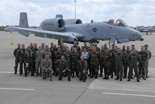 The Airmen of the 107th Fighter Squadron stand with one of their newly-assigned aircraft, an A-10 Thunderbolt II. The 107th, which is assigned to Selfridge Air National Guard Base, Mich., recently completed the transition from flying F-16 Fighting Falcons to flying the A-10. (U.S. Air Force photo by Technical Sgt. David Kujawa)