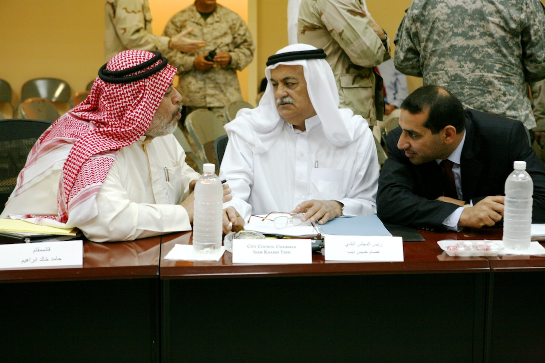 From left to right; Rawah's town mayor; Hamid Khaleel Ibrahim; Rawah's city engineering supervisor; Husam Rushid Muhsen; and Rawah's city council chairman Isam Khamid Theb discuss plans for their city's future at the Civic Leaders Conference held at Al Asad Air Base; May 4; 2009. City leaders from Western Al Anbar gathered to discuss ways to overcome their cities' problems.