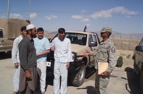 Master Sgt. Dewane Brown practices the Dari language and talks with patients outside of a hospital located near the Pakistan border in Afghanistan. In addition to his medical logistics duties, Sergeant Brown volunteers his off-duty time to teach English to the Afghan National Army three times a week.