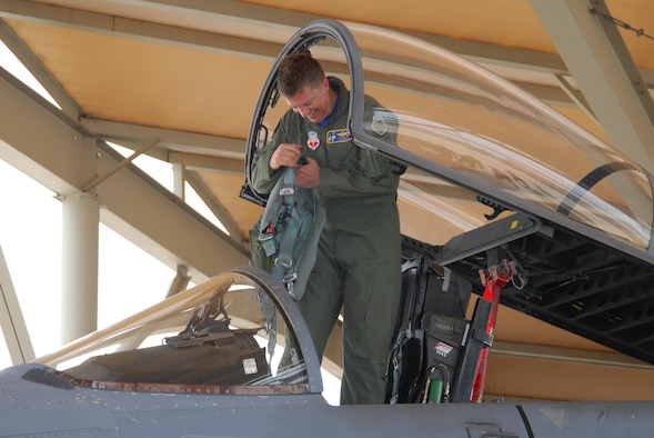 Col. Randy Spear, 601st Air and Space Operations Center vice commander, exits his F-15 after taking his final flight. (Air Force Photo by: Ms. Lisa Norman)
