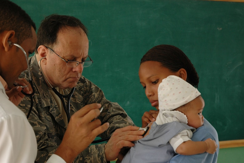 AZUA, Dominican Republic - U.S. Air Force Reservist Col. Larry Woods, assigned to the 910th Medical Squadron, examines a Dominican child in the Family Care section of Dominican Republic Medical Readiness Training Exercise (MEDRETE) here. Col. Woods is a member of a team of more than 30 Citizen Airman providing much needed medical care to more than 10,000 Dominican residents during this mission. The group left Youngstown Air Reserve Station, Ohio on April 25 and is scheduled to return on May 8. (U.S. Air Force photo by Tech. Sgt. Dennis J. Kilker Jr.)