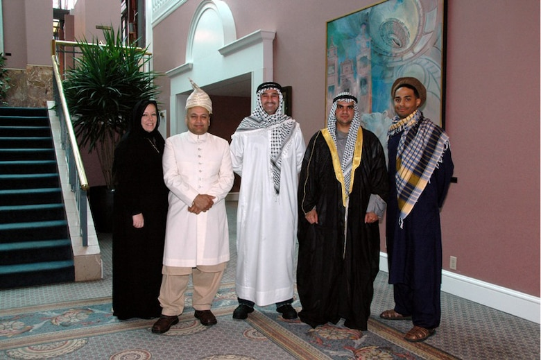 Trainers from the Current Operating Enviroment, Culture and Cross Cultural Competencies Workshop at the 2009 National Guard Diversity Conference pose in native dress.  The workshop emphasized a better understanding of middle eastern culture and diversity. (l to r) Ms. Ann O'Connor, Trainer, MSG Mahmood Qadri, AR-ARNG, SGT Michael Turk, TX-ARNG, 2Lt Haidar Hamoud, NE-ARNG, 2Lt Rafael Lantigua, Jr., NE-ARNG (Photo by MSgt. Mary-Dale Amison)