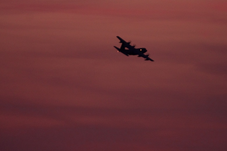 An MC-130P Combat Shadow aircraft carrying Airmen from the 129th Rescue Wing takes off from Moffett Federal Airfield, Calif., for a deployment to the Horn of Africa. Thirty Airmen from the 129th Rescue Wing departed on two MC-130P aircraft for a 40-day deployment to Djibouti, Africa, April 21, 2009. (Photo courtesy of Mr. Sagar Pathak, www.horizontalrain.com)