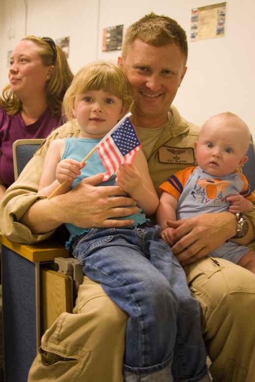 Capt. Patrick Slavin, 130th Rescue Squadron C-130 pilot, poses with his children before his deployment to the Horn of Africa. Thirty Airmen from the 129th Rescue Wing departed on two MC-130P Combat Shadow aircraft for a 40-day deployment to Djibouti, Africa, April 21, 2009. (Photo courtesy of Mr. Sagar Pathak, www.horizontalrain.com)