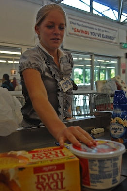 Chelsea Bachmann, commissary bagger, bags a customer's groceries, Ramstein Air Base, Germany, April 23, 2009. Commissary baggers are self-employed and work under a license agreement with the installation commander. (U.S. Air Force photo by Airman 1st Class Tony R. Ritter)