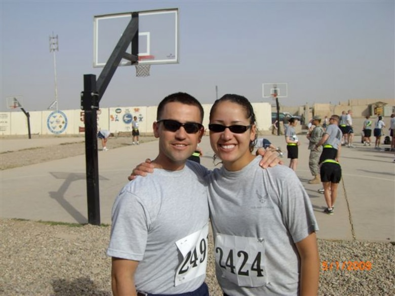 Tech. Sgt. Sam A. Ruiz and Senior Airman Sheryl N. Job, both from the 119th Wing Security Forces Squadron, North Dakota Air National Guard take a break before running in a 5K race in Iraq.  Ruiz is planning to run in the full Fargo Marathon from Iraq on May 9th.