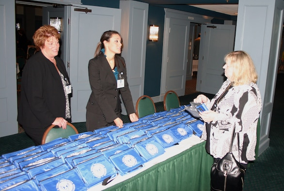 Rebecca Dominguez (left) and Amber Shipp, of the Air Force Personnel Center's Airman, Family and Community Operations Branch, answer questions April 28 from an Air Force transition assistance expert at the Menger Hotel in downtown San Antonio.  About 120 TA professionals from across the Air Force met in San Antonio for a three-day confererence to learn the latest in Air Force career and employment initiatives. (U.S. Air Force photo/Richard Salomon)