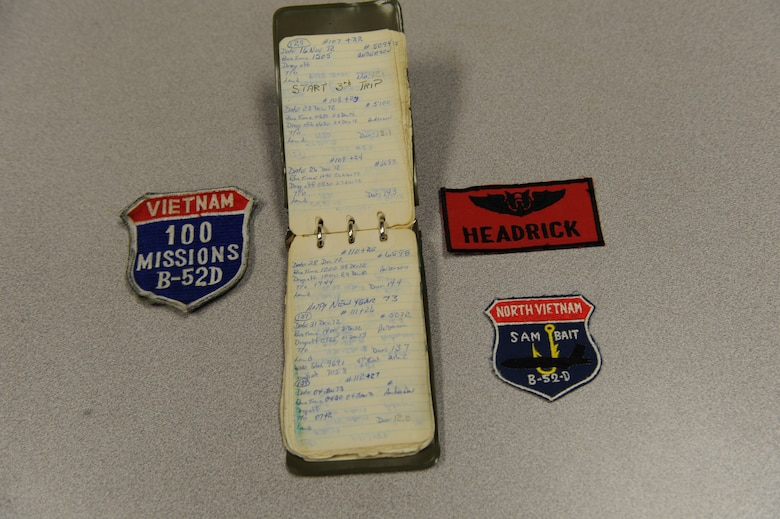 WHITEMAN AIR FORCE BASE, Mo. – An arrangement of flight patches and a flight log maintained by retired Master Sgt. Jerry Headrick, a former B-52 tail gunner.   Mr. Headrick flew 2000 combat hours and was awarded 10 Distinguished Flying Crosses during the Vietnam War. (US Air Force Photo/Senior Airman Jason Huddleston)