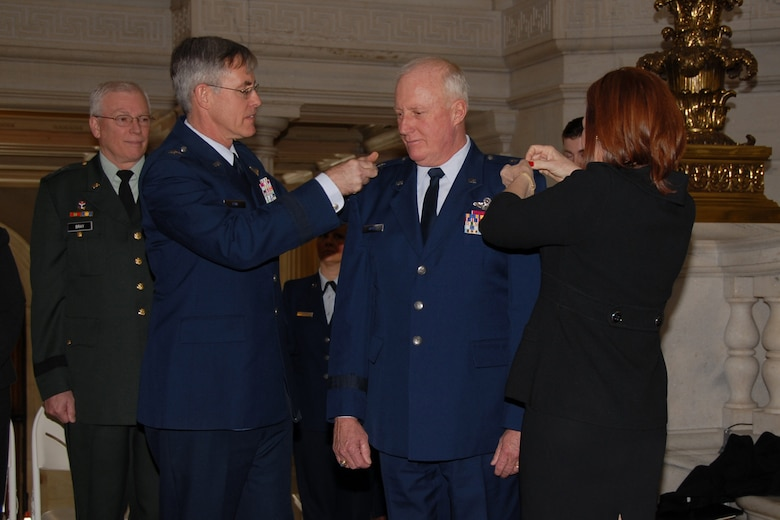 Major General (MG) Thomas J. Haynes, Air National Guard (ANG) assistant to the commander, Air Mobility Command (AMC), and former Assistant Adjutant General for Air, Rhode Island Air National Guard (RIANG), was promoted to Major General in the Rhode Island State House Rotunda, Providence, RI. MG Haynes was pinned by his wife, Barbara and MG (ret) Thomas Kane, former director of plans and programs for AMC. USAF Photo taken by Technical Sergeant Jason Long (Released)