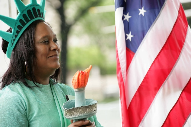 Tonya Bush, who works for U.S. Immigration services, volunteered to play the role of the Statue of Liberty May 7 during Public Service Recognition Week. The four-day event is a once-a-year chance for federal, state and local governments to showcase their services. Around 100,000 individuals made an appearance during the festivities.
