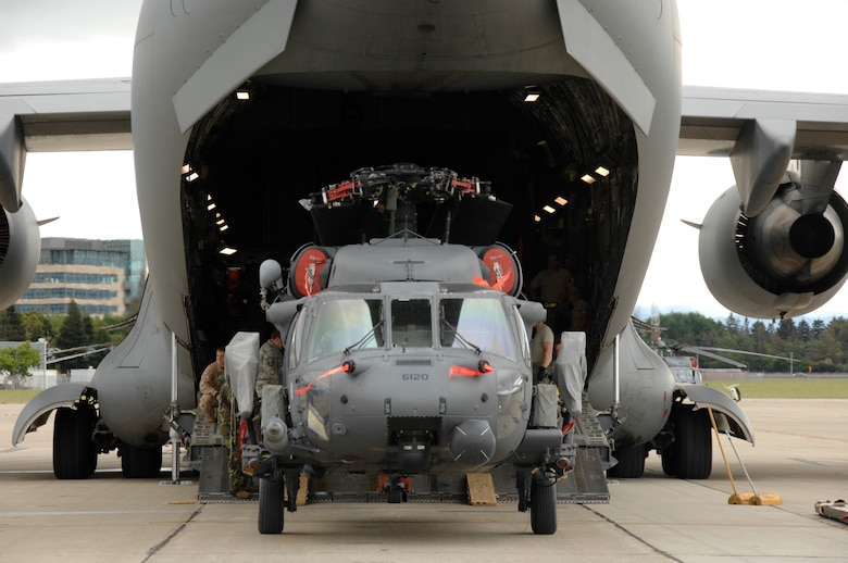 An HH-60G Pave Hawk rescue helicopter from the 129th Rescue Wing, Moffett Federal Airfield, Calif., is prepped for loading in a C-17 Globemaster.  More than 50 Airmen and three Pave Hawks from the 129th Rescue Wing deployed to Afghanistan May 3, 2009. (U.S. Air Force photo by Master Sgt. Dan Kacir)
