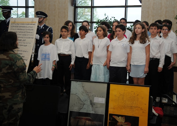 SCOTT AIR FORCE BASE, Ill. -- Children from The Solomon Shecter Day School of St. Louis sing the National Anthem at the start of the Holocaust Remembrance breakfast inside the Scott Club April 30. At the breakfast, members of Team Scott ate a kosher meal while listening to the stories and personal experiences told by Holocaust survivors Jerry Koenig and Fred Ashner. (U.S. Air Force photo/Airman 1st Class Wesley Farnsworth)