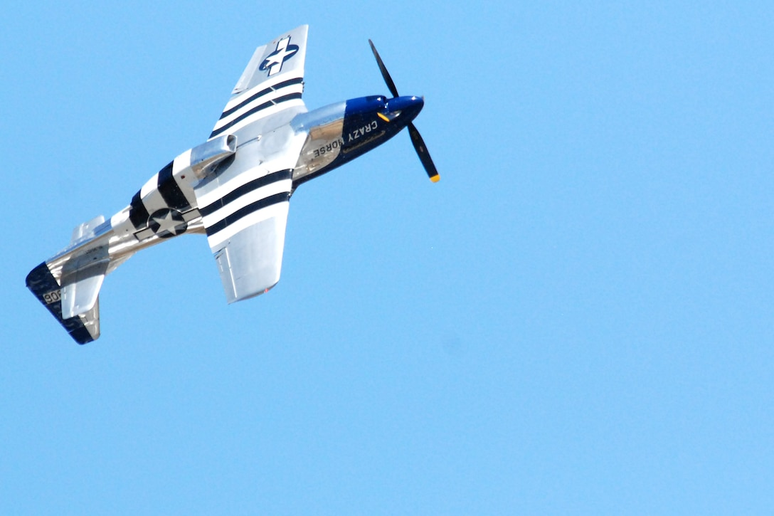 A P-51 Mustang performs aerial maneuvers for a crowd May 1 at Eglin Air Force Base, Fla. The P-51 later flew in formation with an F-15 Eagle as part of a Heritage Flight. The P-51 was assigned to the Eglin AFB 33rd Fighter Wing from 1948 through 1950, and was a workhorse during World War II. (U.S. Air Force photo/Staff Sgt. Mike Meares)