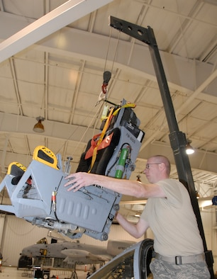 Staff Sgt. Anthony Bonham, an Air Force reservist with the 442nd Maintenance Squadron's Egress shop, carefully swings an ACES II ejection seat into position for installation into an A-10 Thunderbolt II, which belongs to the 442nd Fighter Wing at Whiteman Air Force Base, Mo. Sergeant Bonham and the other reservists in the Egress shop maintain the ejection seats to help ensure pilots have a way to safely and effectively leave the aircraft in the event of an emergency. (US Air Force photo/Master Sgt. Bill Huntington)