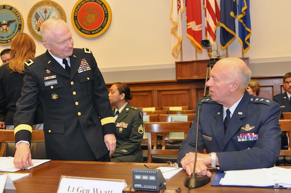 Maj. Gen. Raymond W. Carpenter, acting deputy director of the Army National Guard, and Lt. Gen. Harry M. Wyatt III, director of the Air National Guard, prepare to testify before the House Armed Services Committee Air and Land Forces Subcommittee on May 5, 2009. (U.S. Army photo by Staff Sgt. Jim Greenhill) (Released)