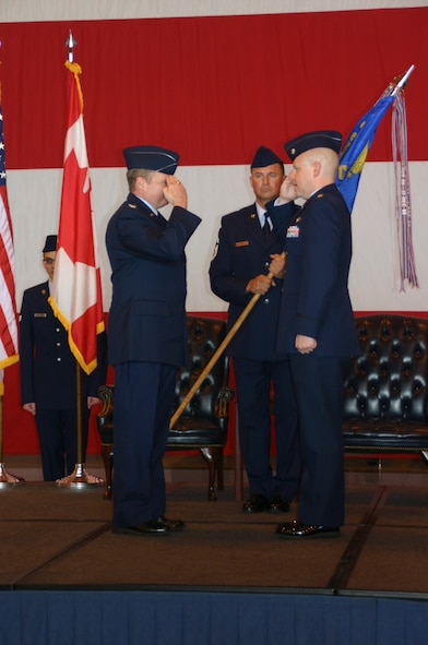 Lieutenant Col. Greg Kent salutes his new boss, Col. George Carpenter, commander, 552nd Operations Group, after taking command of the 966th Airborne Air Control Squadron.