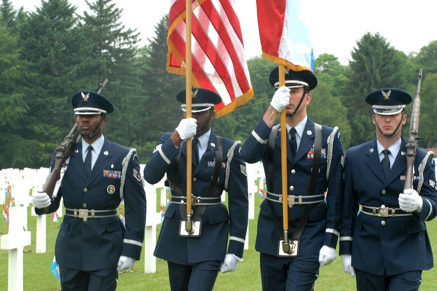 LUXEMBOURG CITY, Luxembourg – Airmen of the 52nd Fighter Wing Honor Guard present the colors during a Memorial Day ceremony at the Luxembourg American Cemetery and Memorial May 24, 2008. Many of the cemeteries in Belgium, the Netherlands and Luxembourg, where U.S. servicemembers are buried, have local nationals who have adopted the American graves. It is common for them to honor the fallen servicemembers on Memorial Day by decorating the graves as an expression of appreciation for their freedom and the sacrifices made by Americans on their behalf. (U.S. Air Force photo by Staff Sgt. Logan Tuttle)