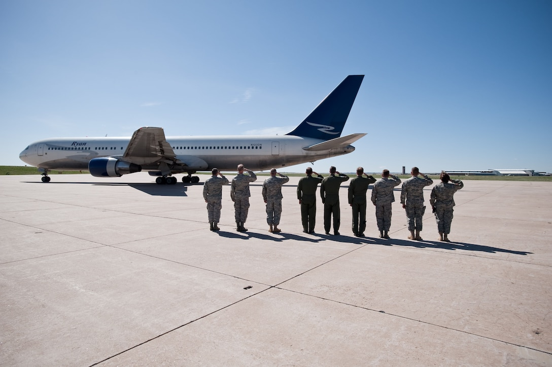 Commanders and senior staff of the Colorado National Guard Joint Force Headquarters and 140th Wing salute the departure of more than 200 Airmen deploying to Iraq in support of Operation Iraqi Freedom. (U.S. Air Force photo/Master Sgt. John Nimmo, Sr.) (RELEASED)