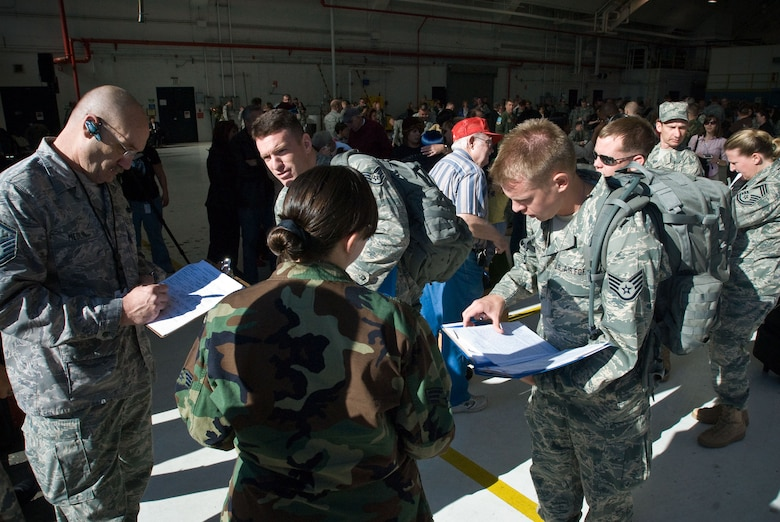 Colorado Air National Guardsmen from Buckley Air Force Base, Aurora, CO, verify their paperwork is in order before departing for Iraq. More than 200 Airman volunteered to deploy to Iraq in support of Operation Iraqi Freedom. (U.S. Air Force photo/Master Sgt. John Nimmo, Sr.) (RELEASED)