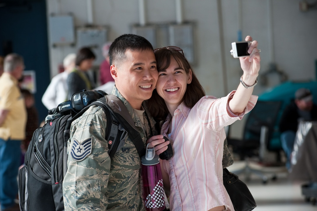 Technical Sgt. Clifton Moy, 140th Maintenance Squadron, Colorado Air National Guard, Buckley Air Force Base, Aurora, CO, poses for a self-portrait with fianc? Jessica. (U.S. Air Force photo/Master Sgt. John Nimmo, Sr.) (RELEASED)
