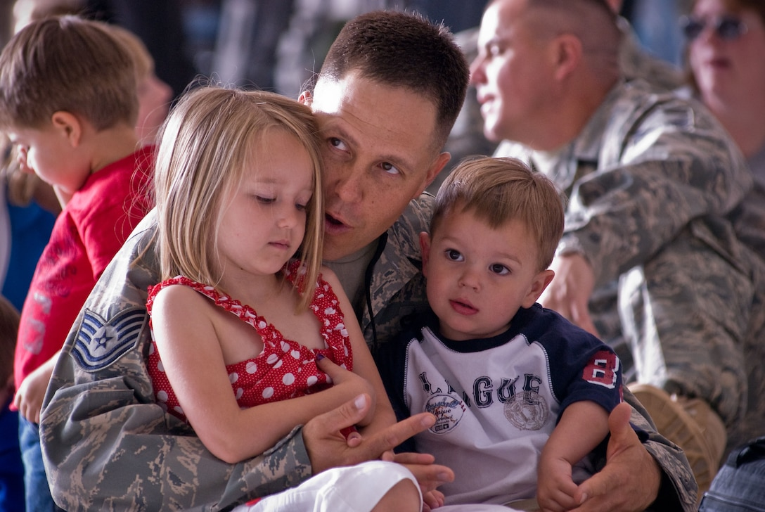 Technical Sgt. William Schmidt, 140th Aircraft Maintenance Squadron, Colorado Air National Guard, Buckley Air Force Base, Aurora Colorado, talks with his daughter Shealie and son Rylan as he waits to hear his name called just prior to deploying to Iraq. (U.S. Air Force photo/Master Sgt. John Nimmo, Sr.) (RELEASED)