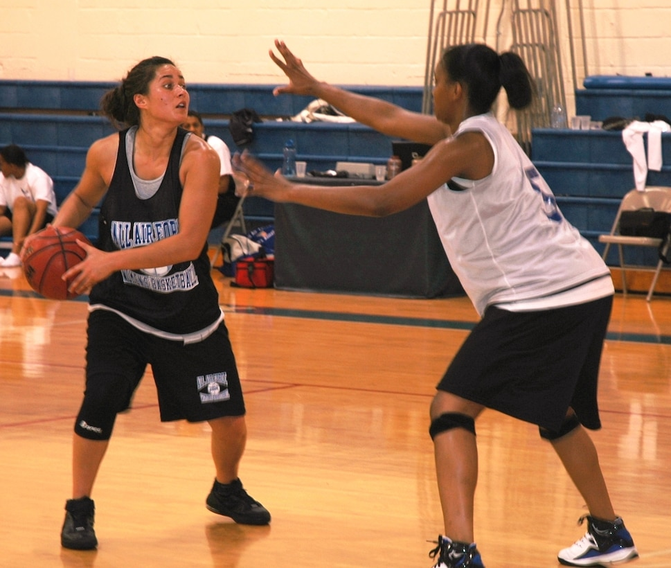 2nd Lt. Andrea Taylor tries to get past Senior Airman Richere Harrison during practice for the Air Force Women's Basketball Team at the Patrick Fitness Center April 30. (U.S. Air Force photo/Tech. Sgt. Lisa Luse)