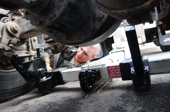 Senior Airman Thomas Smart, 28th Logistics Readiness Squadron vehicle operator, checks the position of the hydraulic under lift on a 5-ton wrecker to slide it under a vehicle for towing.  Proper positioning ensures safety when lifting vehicles. (U.S. Air Force photo/Senior Airman Anthony Sanchelli)