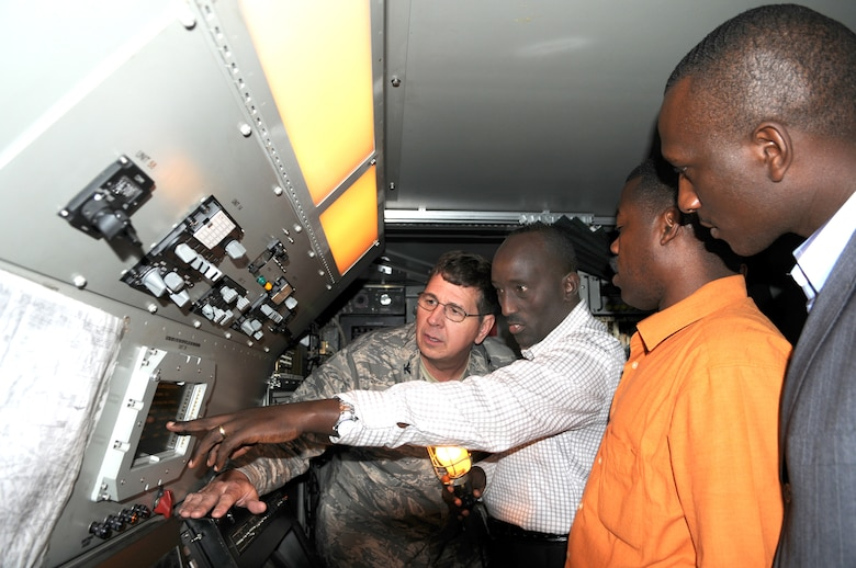 KIGALI, Rwanda -- Engineer Eustache Karagire (center) explains the Rwandan Aerospace Management System radar to Col. Robert McGrath, 145th Airlift Wing, Charlotte, N.C. Air National Guard, while Lt. Sylvester Manirambona (right from center) and Mr. Innocent Minega (right) look on during a theater security cooperation event April 28.