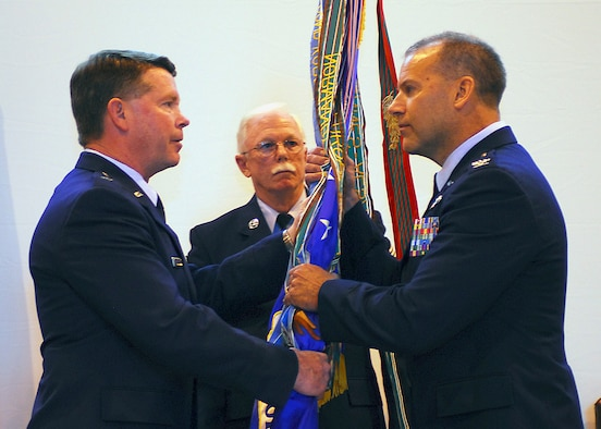 Colonel Kenneth Nereson, right, accepts the guidon from Brigadier General John Nichols as he assumes command of the 149th Fighter Wing, Texas Air National Guard, Lackland AFB, Texas on April 17, 2009. (Air National Guard photo by SSgt Eric Wilson) (RELEASED)