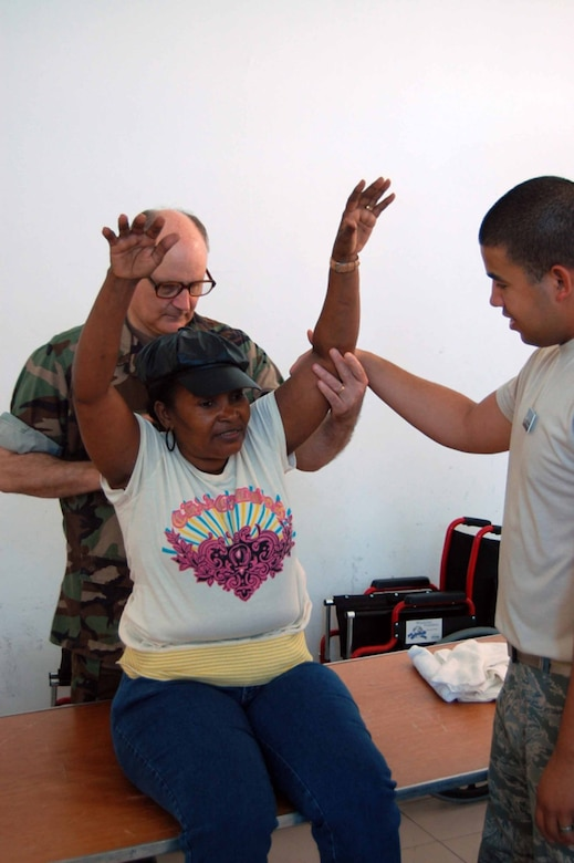 ST. JOHN'S, Antigua (May 8, 2009) -- Navy Lt. Commander Dan Gage, a staff physical therapist aboard hospital ship USNS Comfort (T-AH 20) and Air Force Staff Sgt. Hugo Reiner, a physical therapy craftsman aboard Comfort, assess Teresa De la Pena's back pain as part of Continuing Promise 2009, a four month humanitarian and civic assistance mission through Latin America and the Caribbean. (U.S. Air Force photo by Airman 1st Class Danielle Grannan)
