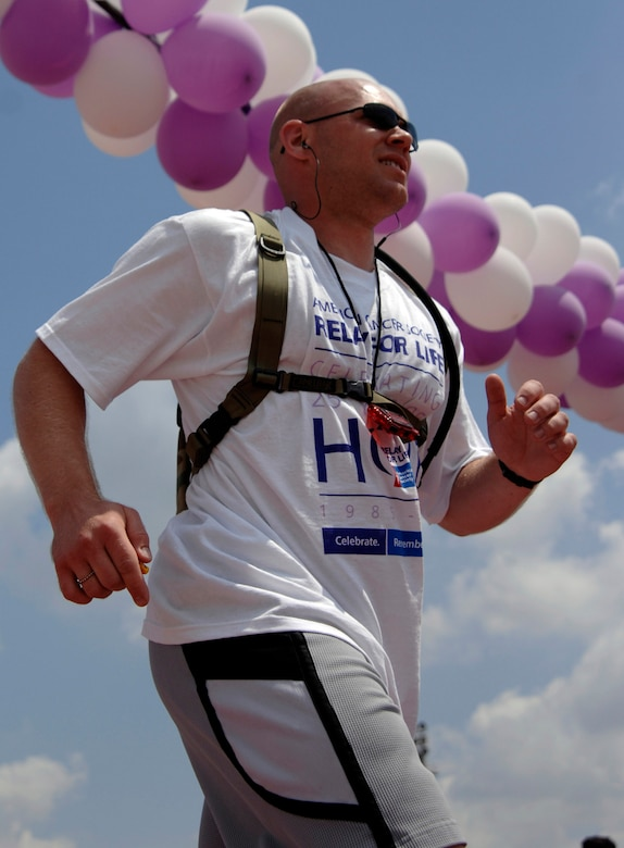 Staff Sgt. Joseph Gibbon, 39th Air Base Wing chapel, crosses the check point during the Relay for Life at the Incirlik running track, May 9, 2009. The 2009 Relay for Life was the first relay available to members of the Incirlik community and hosted more than 300 participants from 20 teams, raising more than $9,500. The event lasted 12 hours and included a luminaria ceremony in which participants wrote the names of cancer survivors and victims on more than 100 luminary bags. (U.S. Air Force photo/Senior Airman Benjamin Wilson)