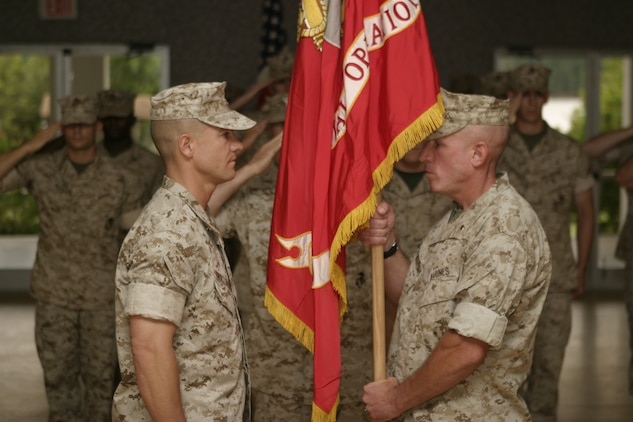 MARINE CORPS BASE CAMP LEJEUNE, N.C. — Lt. Col. Christian L. Nicewarner (Right) hands the unit colors of 3d Marine Special Operations Battalion, U.S. Marine Corps Forces, Special Operations Command over to Lt. Col. Matthew G. Trollinger (Left) in a change of command ceremony, here May 11. This change of command ceremony followed a re-designation ceremony in which Companies A and B of the Marine Special Operations Advisor Group were officially re-designated as 3d and 4th MSOB.