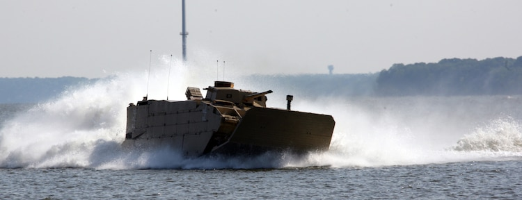 An Expeditionary Fighting Vehicle, operated by Marines with the Amphibious Vehicle Test Branch out of Marine Corps Base Camp Pendleton, Calif., whips through the Potomac River training area just off the Quanitco shorline in a testing evolution May 12.